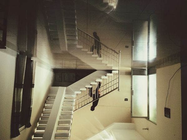 Interior Views Stairs Stairways Staircase Going Up One Man Steps Reflection Symmetry Confusion Upside Down Floor Empty Space Yellow Open Door Interior Architecture Low Light Taking Steps Minimalism Individuality Q For Quiet