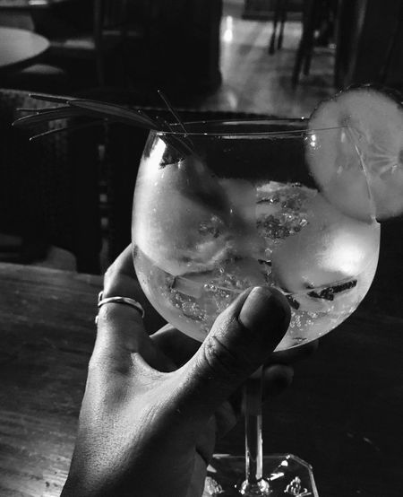 Gin - cheers! EyeEm Selects Real People One Person Holding Refreshment Drink Glass Lifestyles Hand Human Hand Food And Drink Indoors  Close-up Drinking Glass Leisure Activity Glass - Material Human Body Part Women Drinking Finger Modern Hospitality The Still Life Photographer - 2018 EyeEm Awards