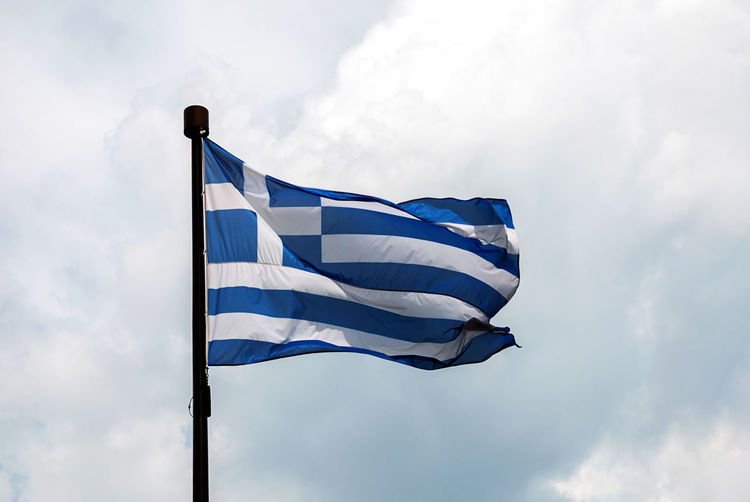 Flag of greece  -  low angle view of flag against sky