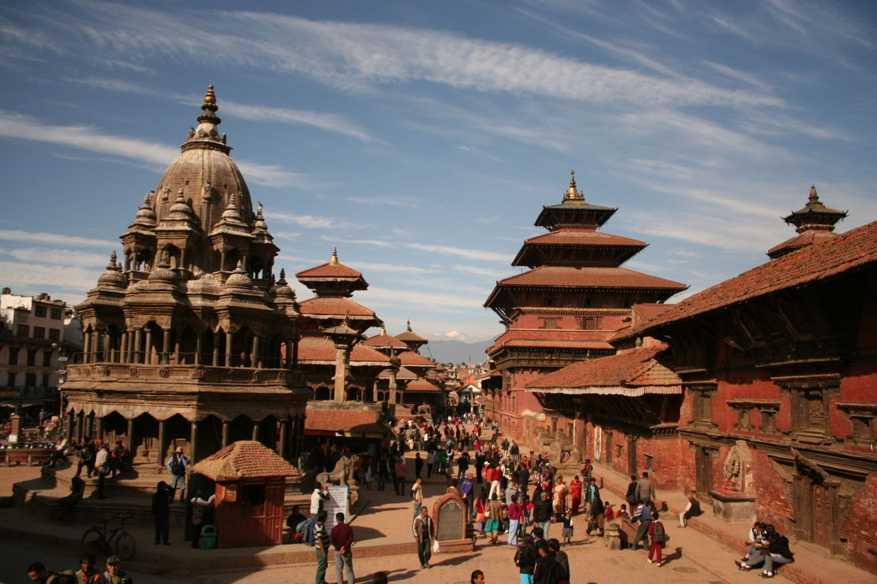 built structure, architecture, large group of people, building exterior, sky, tourism, travel destinations, place of worship, travel, real people, history, cloud - sky, spirituality, religion, day, outdoors, leisure activity, lifestyles, men, sunlight, women, vacations, ancient civilization, people