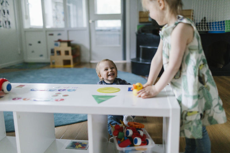 Children playing with toy at home