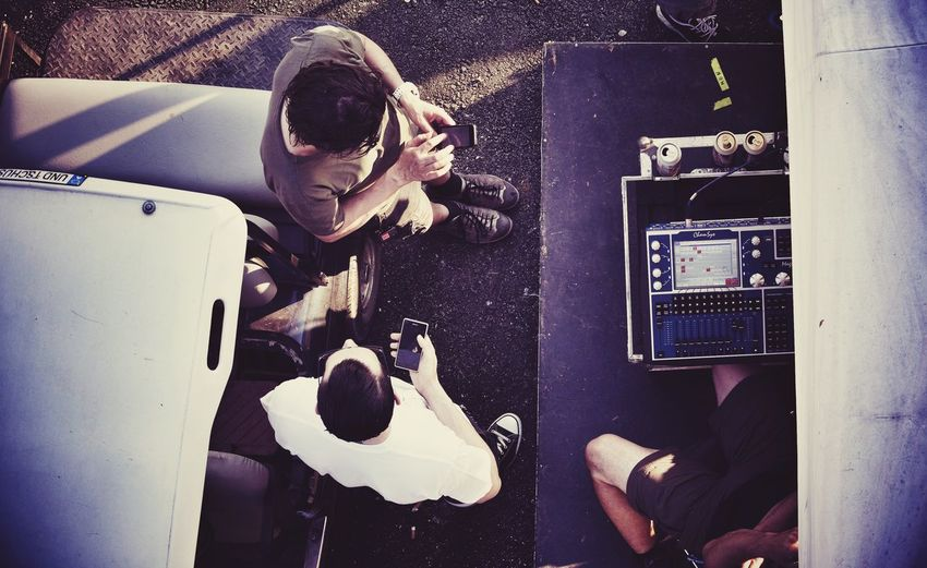 Directly Above View Of People Standing By Golf Cart With Sound Recording Equipment