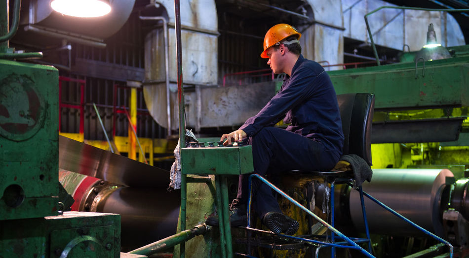 Russia, Yekaterinburg, Upper Iset plant, steel cold rolling mill Casual Clothing Day Leisure Activity Lifestyles Portrait Russia, Yekaterinburg, Upper Iset Plant, Steel Cold Rolling Mill Sitting Steel Cold Rolling Mill