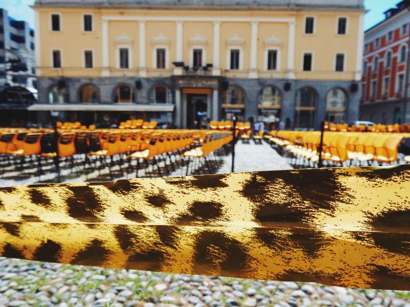 Festival del Film, Locarno Architecture Built Structure Canal City City Life Day Film Festival Locarno Nature No People Outdoors Selective Focus Surface Level Switzerland The Golden Lepard Water The Golden Leopard Paint The Town Yellow