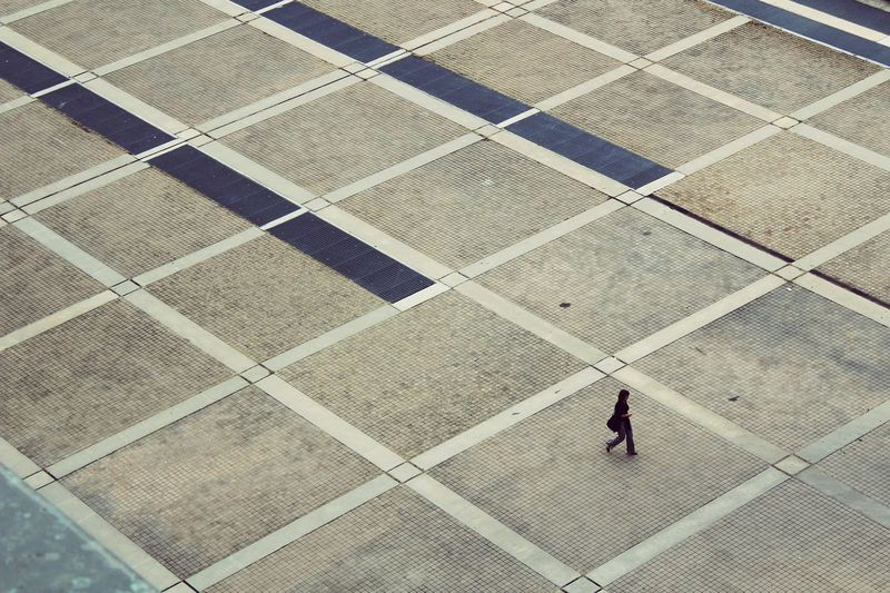 Pattern High Angle View Real People Outdoors One Person Day Architecture EyeEmNewHere minimalism Minimalism Photography Geometry Pattern Geometry Everywhere Walking Around The City  Lonely Women Around The World Flying High Long Goodbye ミーノー!! The Street Photographer - 2017 EyeEm Awards BYOPaper! EyeEm Selects Breathing Space The Week On EyeEm Lost In The Landscape The Street Photographer - 2018 EyeEm Awards