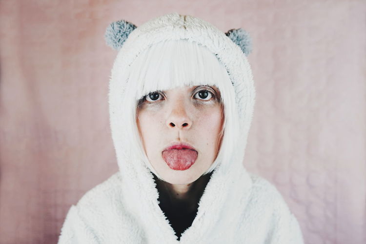 Carnival Adult Adults Only Beautiful Woman Beauty Close-up Cold Temperature Costume Cute Headshot Human Body Part Human Face Indoors  Knit Hat Looking At Camera One Person People Portrait Real People Studio Shot Teddy Bear Warm Clothing Winter Young Adult Young Women