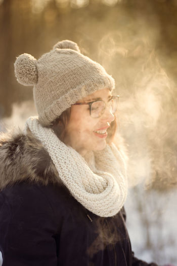Adult Close-up Cold Temperature Day Focus On Foreground Happiness Knit Hat Nature One Person Outdoors People Real People Scarf Smiling Snow Vape Warm Clothing Winter
