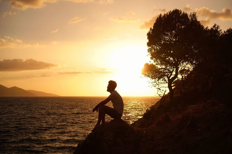 Be. Ready. Sunset Silhouette Sea Nature One Person Tranquil Scene Beauty In Nature Sky Side View Scenics Tranquility Real People Beach Tree Outdoors Water Full Length Men Leisure Activity Sunlight Real Photography The Week On EyeEm Lifestyles Travel Destinations