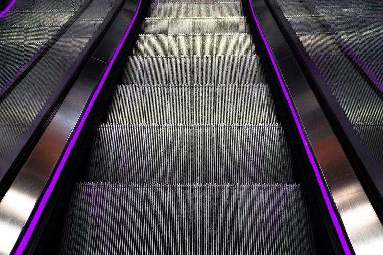 Empty Escalator In Shopping Mall