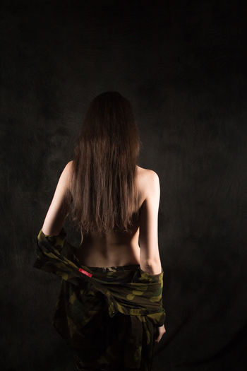 Adult Beautiful Woman Beauty Black Background Clothing Dress Fashion Females Hair Hairstyle Human Hair Indoors  Long Hair Obscured Face One Person Rear View Standing Studio Shot Three Quarter Length Women Young Adult