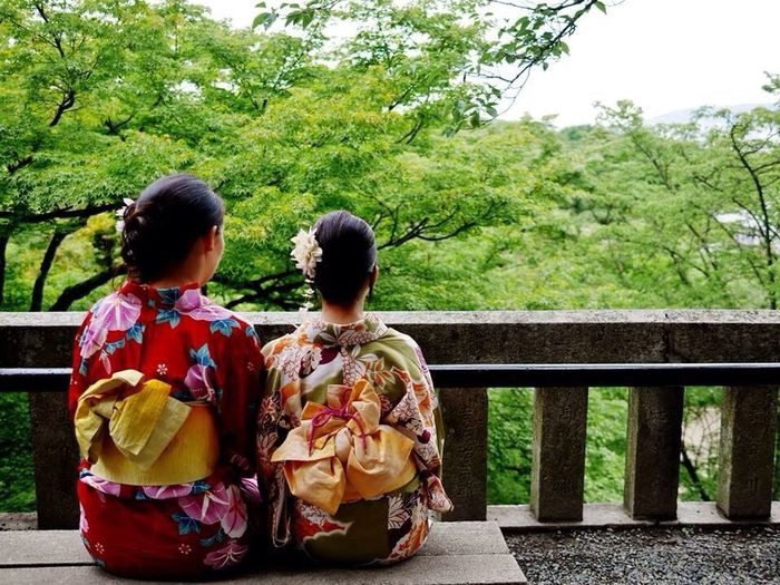 Rear View Of Woman And Girl In Kimonos Looking At Trees