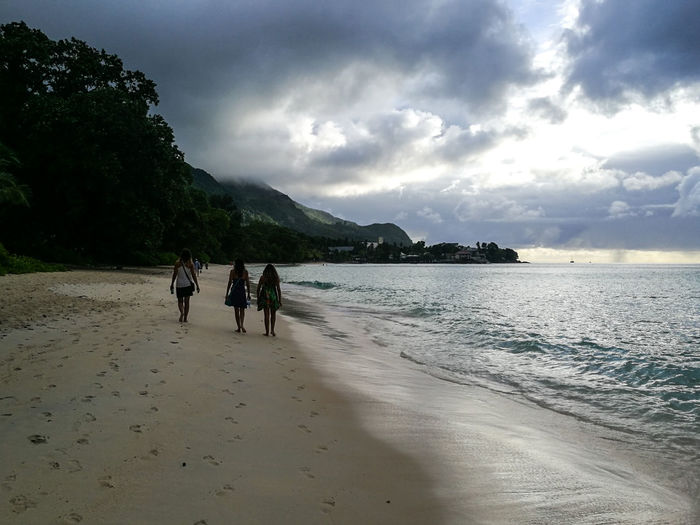 Beach Sand Sea Cloud - Sky Landscape Full Length Nature Vacations Summer Walking Silhouette Water People Sky Leisure Activity Shadow Beauty In Nature Mountain Tree Outdoors Berjaya Beach Seychelles Travel Destinations Aesthetic Tropical Climate Vacation