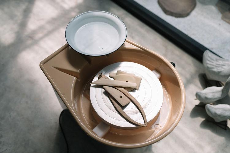 Tools for Ceramic Work Artisan Artist Bowl Ceramic Art Craft Craft Tools Craftmanship High Angle View Preparation  Process Shaping Tools Studio Tools Workshop Workspace