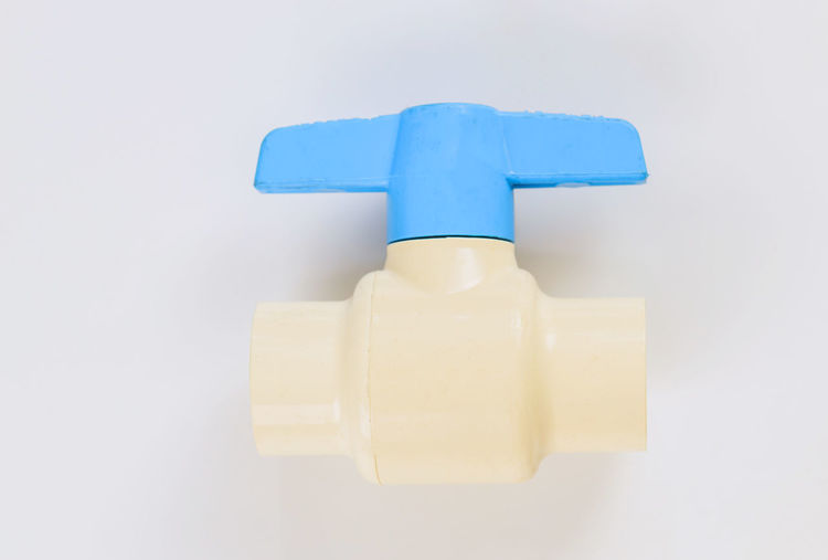 Close-up of blue plastic against white background