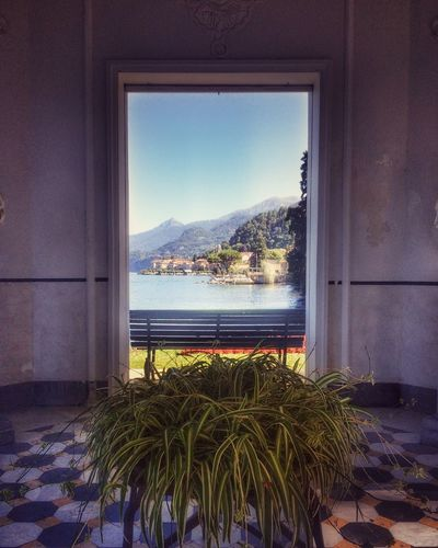 Mountain Indoors  Window Sea Water Plant Clear Sky Blue Scenics Nature Day Growth Tranquility Sky Tranquil Scene Beauty In Nature Mountain Range Tourist Resort Solitude Freshness