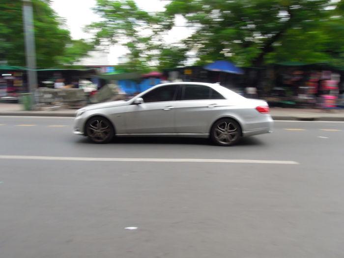 Defocused image of car on road