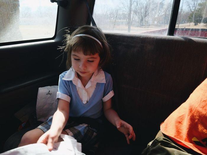 Girl traveling in car