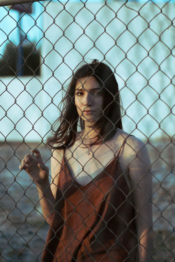 soft spoken Trapped Portrait Shirtless Beauty Females Young Women Prison Standing Chainlink Fence Close-up Fence Thoughtful Blank Expression Introspection Day Dreaming Thinking Eyelid Pretty #FREIHEITBERLIN