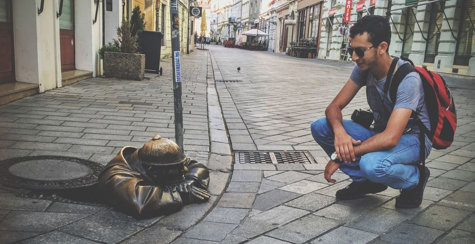 EyeEm Selects Sitting Only Men One Man Only One Person Adult Adults Only One Young Man Only Young Adult Sidewalk Outdoors Street Men Casual Clothing Beard People Young Men Full Length Building Exterior City Lifestyles Bratislava Slovakia Cumil Statue