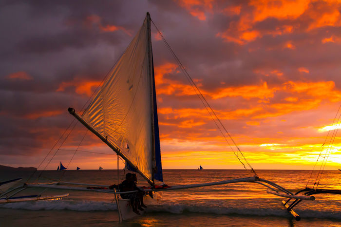 From Boracay island, Aklan province, Philippines. Sailing is a popular sport among locals and visitors. Dark Dramatic Sky Philippines Photos Scenic Sky And Clouds Aklan Boat Boracay Philippines Cloud - Sky Evening Sky Ocean Orange Color Outdoors Outrigger Sail Sailboat Sailing Sea Sea And Sky Ships Silhouette Sky Sport Sunset Water