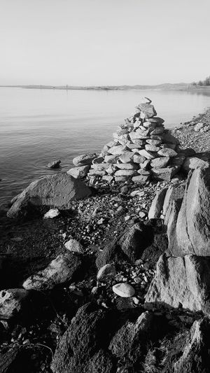 Beach Sea Horizon Over Water Sunlight Day Outdoors Water Nature Tranquility Sky No People Landscape Low Tide Beauty In Nature Blackandwhite Rock Formation Rock Pile EyeEmNewHere