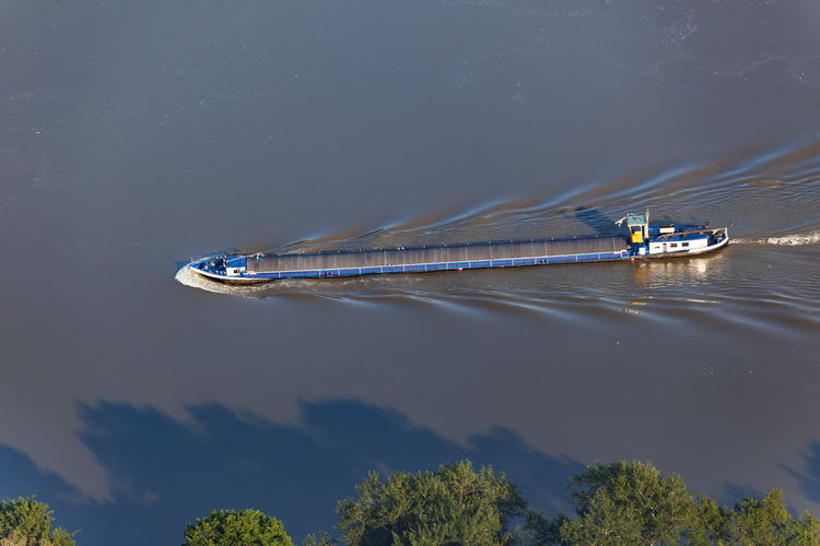 Aerial view of the barge on the danube river and its floodplain in serbiaand croatia