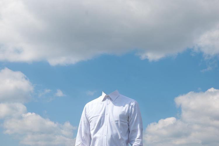 White shirt against cloudy sky