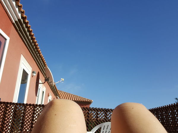 Blue Sky Human Body Part One Person Only Women Blue Sky Relaxing Relaxing Time Relaxing Moments Holiday Relaxing View Relaxing In The Sun Sun Bathing Sunbath Sunny Day Sunny Weather Good Weather Vacation Time Vacations Summertime Holiday Time