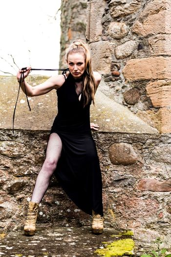 Rebelpunk Mid Life Self Portrait Emotion Day Outside Woman Woman Portrait Adult Portrait Looking At Camera Full Length Outdoors Church Ruin Black Dress Fashion Long Hair One Person Strength Portrait Of A Woman Photo Shoot Bit Of Fun Modern Creative Photography