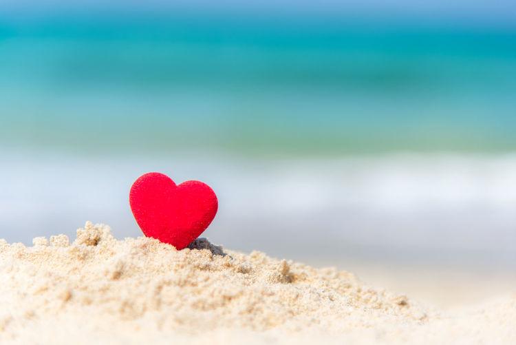 Close-up of heart shape on beach