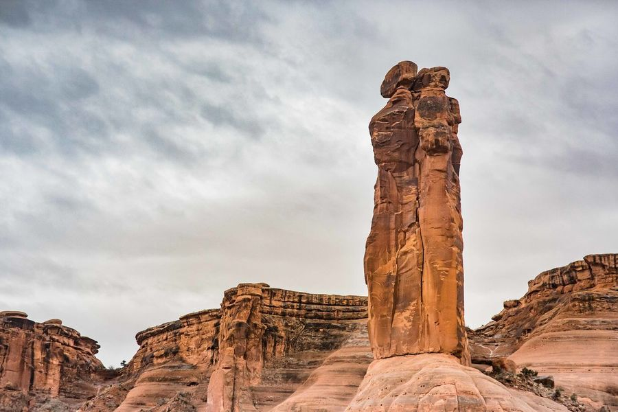 Arches National Park, Utah Cloud - Sky Immovable Low Angle View Monument Physical Geography Rock - Object Rock Formation Stone Material Stone People Tranquil Scene Tranquility Watcher