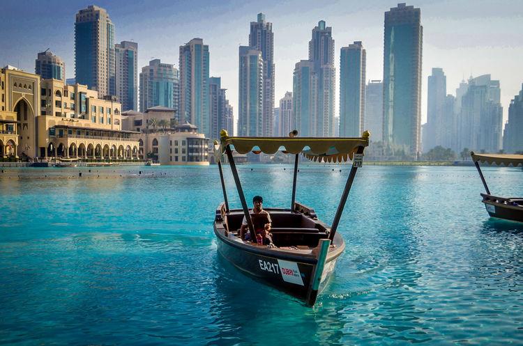 Boats in Downtown Dubai - Dubai - Downtown Dubai - Burj Kalifa waterfront Architecture B Boat Building Exterior Burj Kal City Downtown Dubai Dubai DubaiMall EyeEm Best Shots EyeEm Gallery EyeEmBestPics Lake Skyscraper Tranquility Water Waterfront