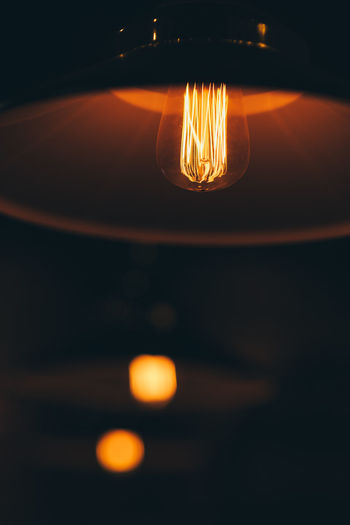 Bulb Illuminated Close-up Lighting Equipment No People Light Bulb Electricity  Indoors  Glowing Orange Color Transparent Glass - Material Light - Natural Phenomenon Reflection Light Dark Focus On Foreground Nature Electric Light Filament Fuel And Power Generation Glass Electric Lamp