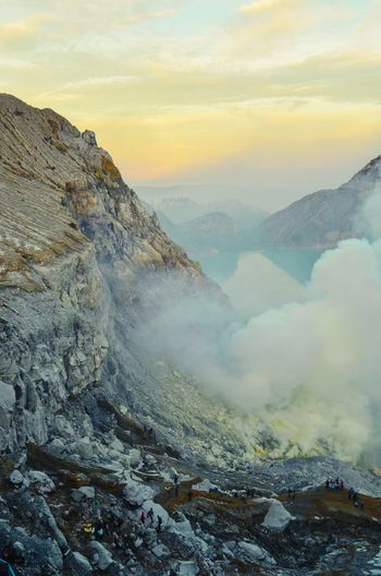 Ijen Crater INDONESIA Mountain Crater Morning Beauty In Nature Landscape EyeEmNewHere EyeEm Selects EyeEm Best Shots Nikon Photography Mountain Environment Scenics - Nature Landscape Sky Beauty In Nature Fog Nature Cloud - Sky Mountain Range Cold Temperature Land Winter Valley Tranquility Snow Travel Tranquil Scene Morning Sun