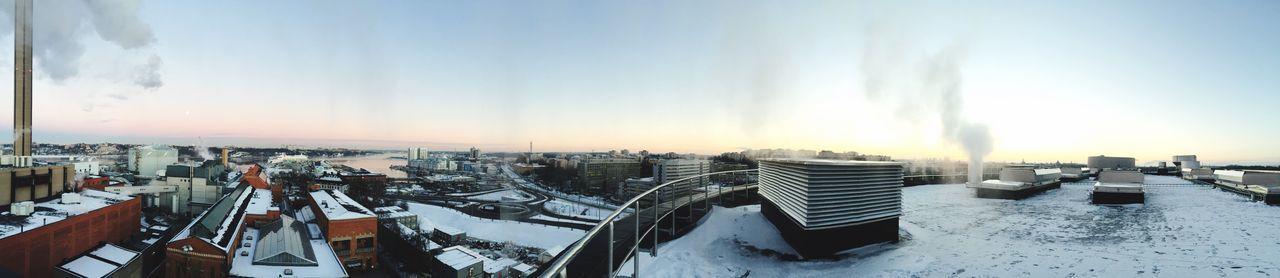 Panoramic view of buildings against sky at dusk