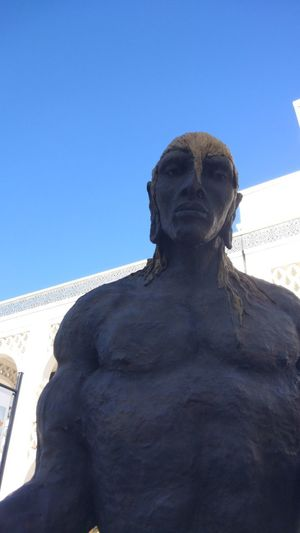 Low angle view of statue against clear blue sky
