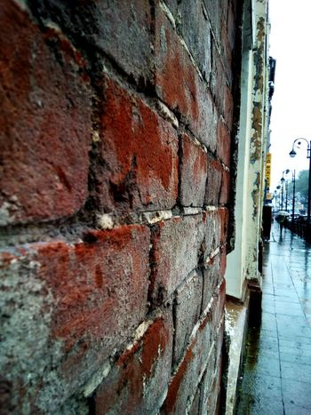 100 years old brick wall Architecture Built Structure Wall - Building Feature Brick Wall Footpath Lamp Post Lamp Posts City Day Rain Raining Rainy Day Cityscape Old