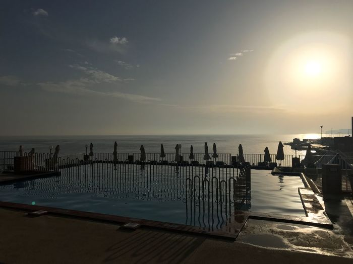 Water Sunset Pool EyeEmNewHere Water Sea Sky Nature Beach Sunset Sunlight Tranquil Scene Built Structure Outdoors No People Horizon Over Water