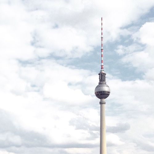 Low Angle View Of Tv Tower Against Cloudy Sky