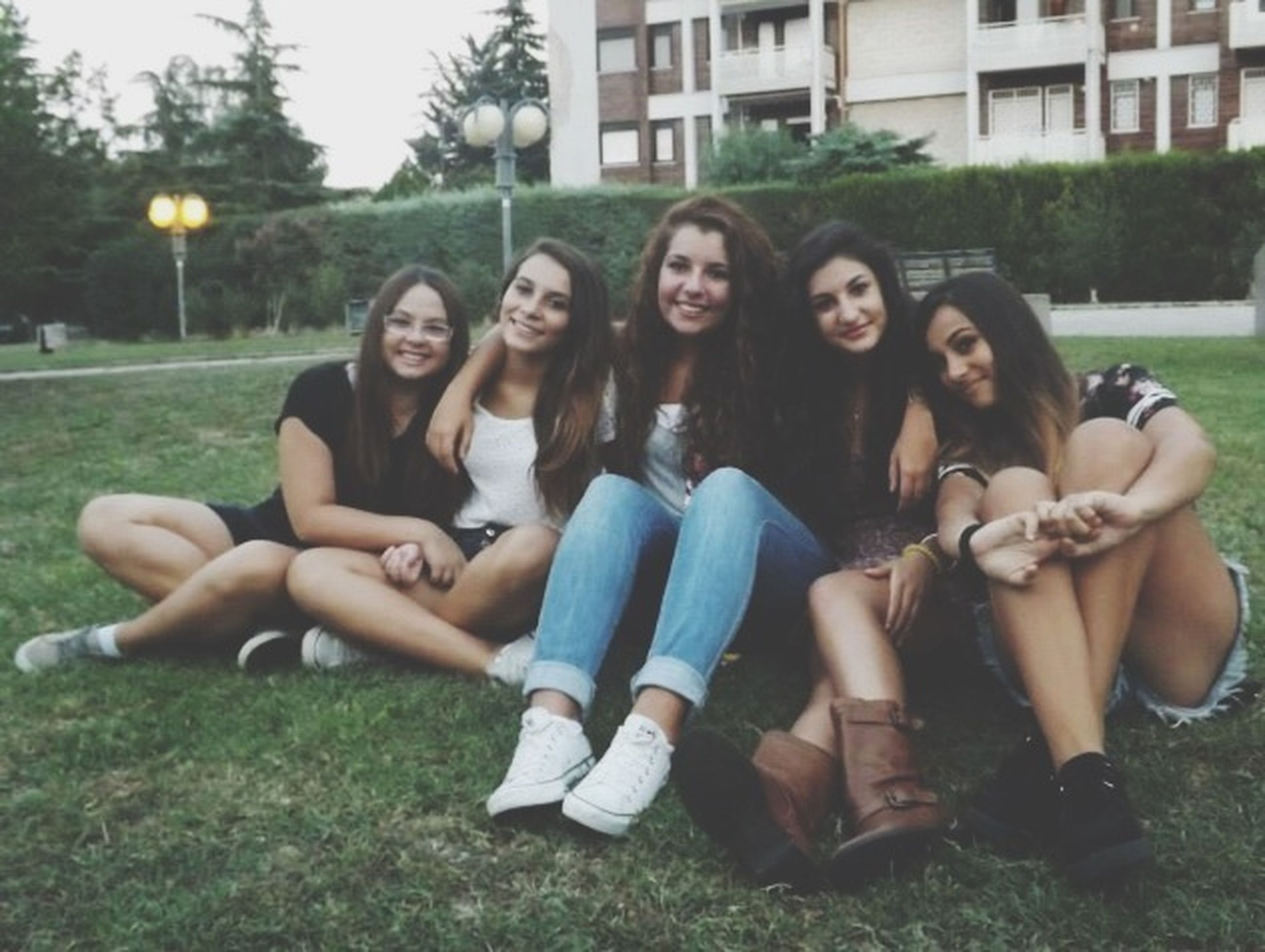 lifestyles, young adult, person, young women, leisure activity, togetherness, bonding, smiling, casual clothing, happiness, love, sitting, looking at camera, friendship, standing, full length, front view