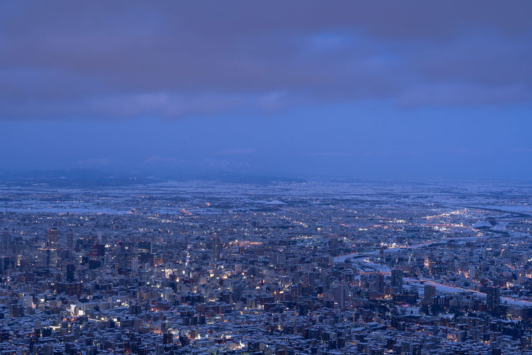 Aerial view of cityscape against sky at dusk