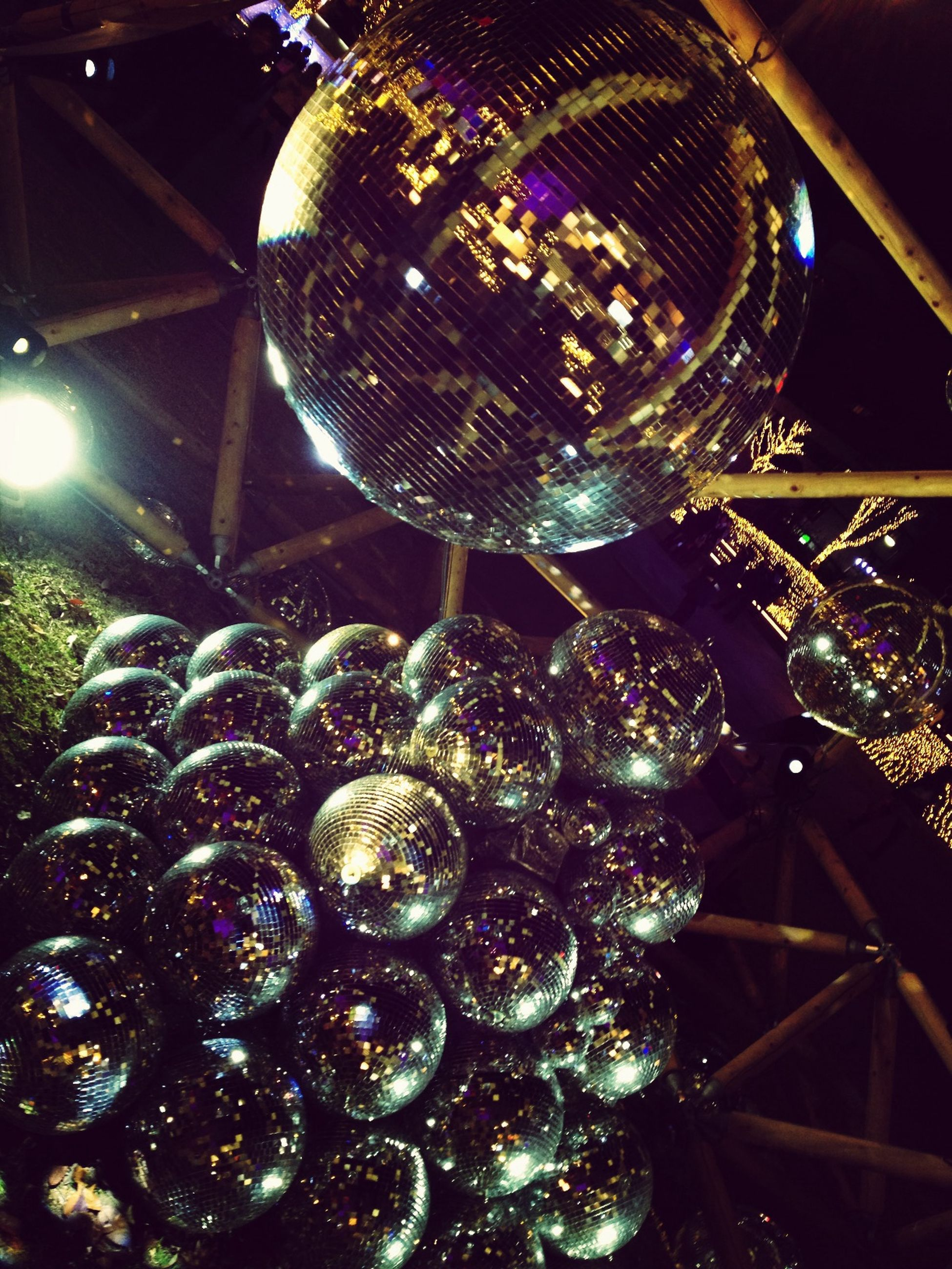 illuminated, decoration, indoors, night, hanging, low angle view, lighting equipment, pattern, christmas decoration, decor, celebration, christmas, design, sphere, christmas lights, christmas tree, abundance, ceiling, shiny, multi colored