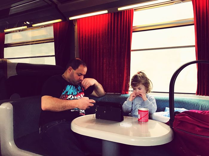 Traveling Train Family Sitting Child Childhood Togetherness Travel Two People Girls People Leisure Activity Indoors  Playing Adult Day