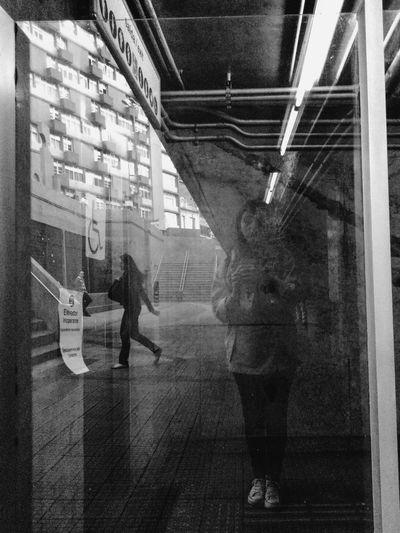 Digital composite image of people walking on glass window