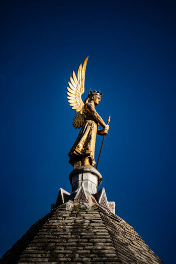 Sculpture Statue Art And Craft Sky Clear Sky Low Angle View Human Representation Blue Representation Architecture No People Female Likeness Nature Travel Destinations Built Structure Creativity Day The Past History Craft Angel Architectural Column