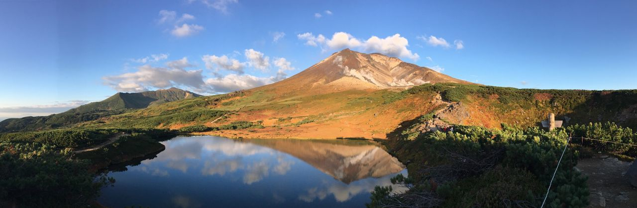 Autumn mountains mirrored in a pond(Hokkaido, Japan) Autumn Mountain Blue Sky With Clouds Hokkaido Mirror Reflection National Park Autumn Mountains Blue Sky Panorama Pond Scenics Tranquil Scene Beauty In Nature Nature Tranquility Sky