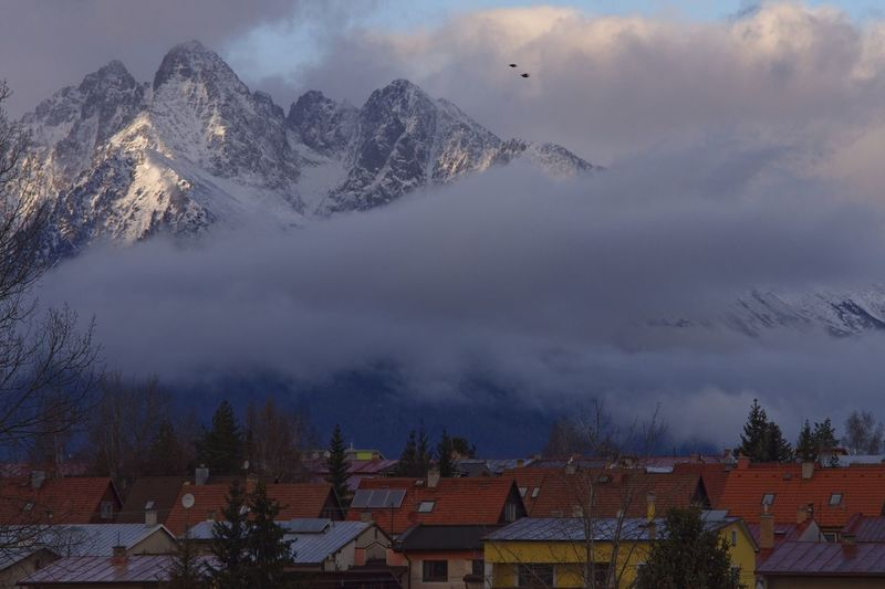 Colourful Slovakia Poprad Winter Mountain Cloud - Sky Cold Temperature Snow Sky Architecture Beauty In Nature Tree Environment Landscape Mountain Range Scenics - Nature No People Snowcapped Mountain Outdoors