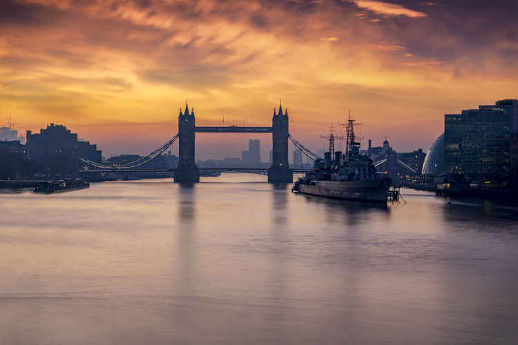 Sunrise behind the iconic Tower Bridge of London, UK Sky Water Cloud - Sky Sunset Architecture Waterfront City Travel Destinations Bridge River Travel Orange Color No People Built Structure London Sunrise Tower Bridge  Tourist Attraction  City Urban United Kingdom Landmark Thames River Dawn Morning
