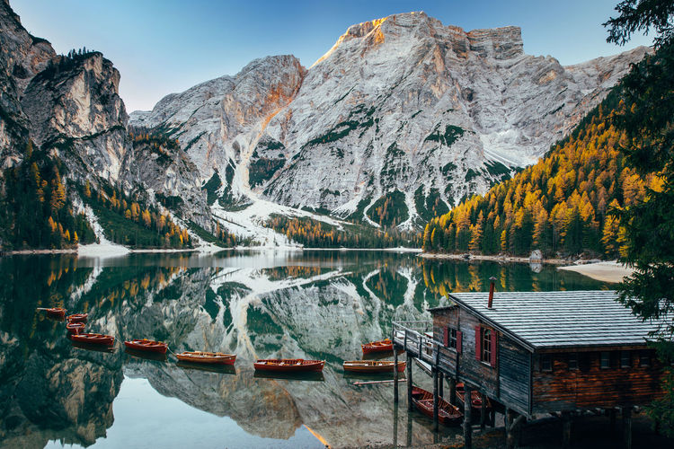 Autumn at Lago di Braies, Italy Mountain Water Beauty In Nature Scenics - Nature Reflection Lake Mountain Range Tranquility Nature Tranquil Scene Sky Idyllic Non-urban Scene Waterfront Day No People Outdoors Formation Lago Di Braies Italy Alps House Boats And Moorings Waterspae Beauty In Nature