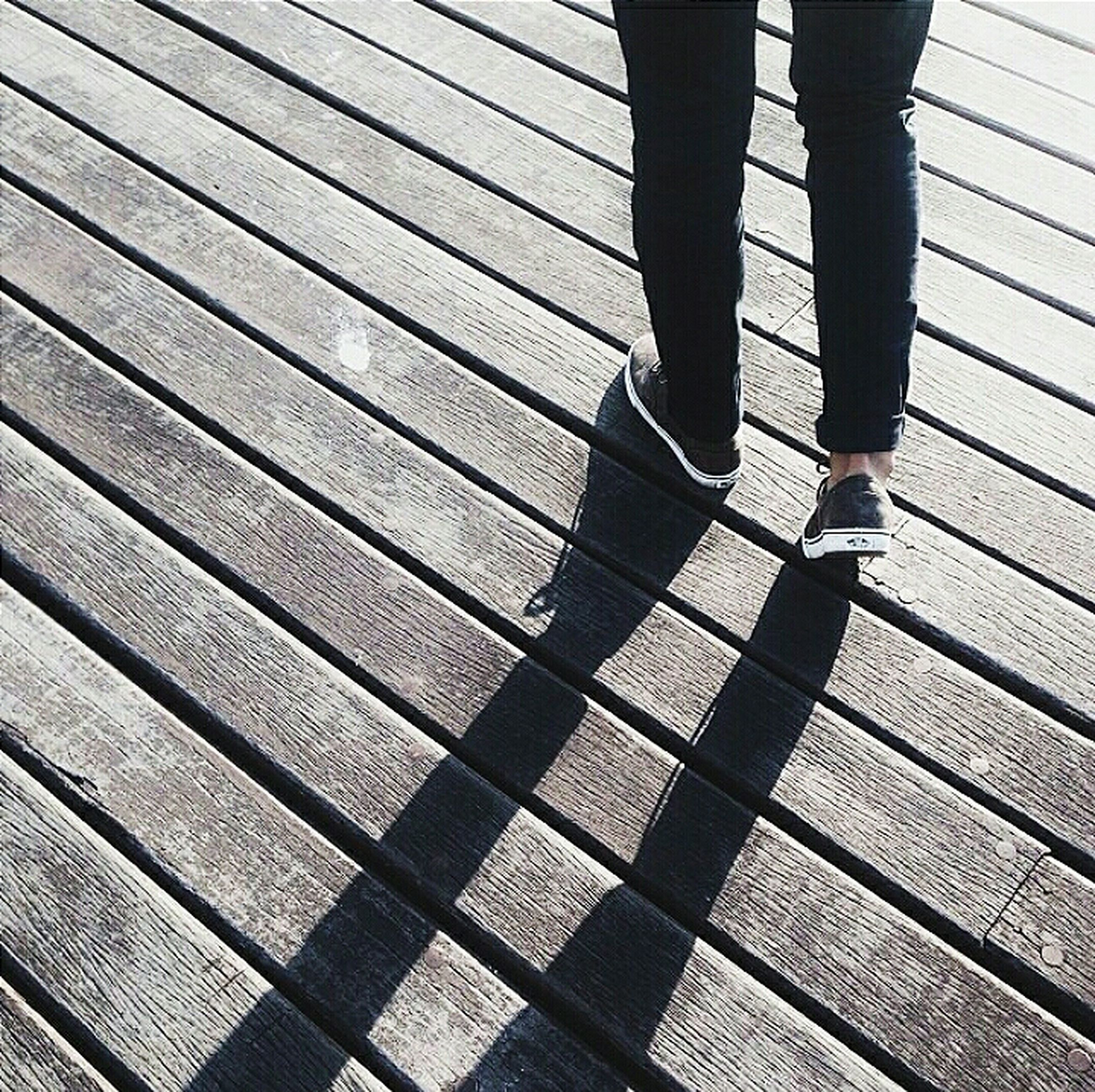 low section, person, lifestyles, standing, men, walking, shoe, human foot, pattern, high angle view, unrecognizable person, leisure activity, footwear, jeans, wood - material, day